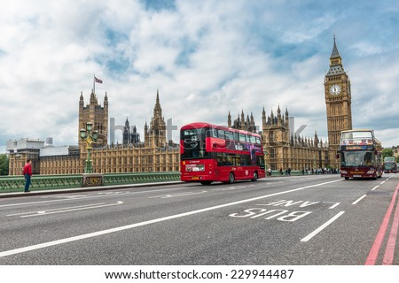LONDON - AUGUST 27, 2014: Buses and tourists cross the Westminster Bridge in front of the Big Ben and Houses of Parliament