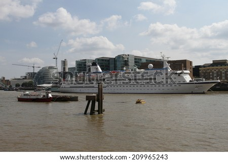 LONDON - AUGUST 1: Cruise ship moored in River Thames near City Hall on August 1, 2014 in London, UK
