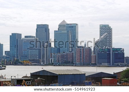 LONDON, ENGLAND - JULY 7, 2016: Canary Wharf, a major business district of London. It incl. Barclays, Citigroup, Credit Suisse, Infosys, Fitch Ratings, HSBC, J.P. Morgan, Moody's,Thomson Reuters etc.