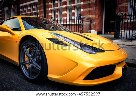 LONDON, ENGLAND - JULY 23, 2016. Yellow Ferrari 458 Speciale parked on street in London.