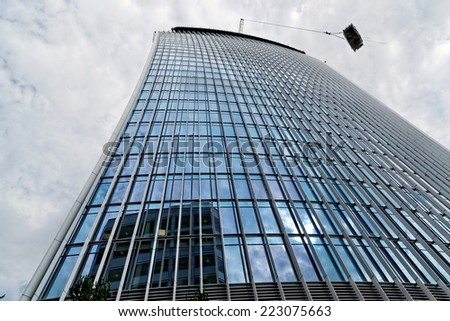 LONDON - JULY 1, 2014. Designed by Rafael Vinoly Architects, the office tower under construction at 20 Fenchurch Street has a distinctive flared shape.