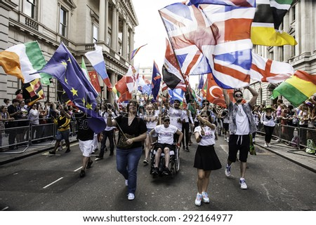 LONDON - JUN 27: The flag-bearers lead the march at the Gay Pride parade on June 27th, 2015, in London cheering the parade, London UK