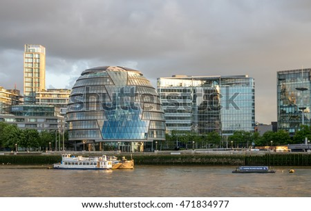 LONDON - MAY 24: City Hall building along river Thames with surrounding buildings in London, England, was taken on May 24, 2016.