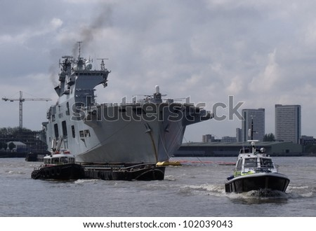 LONDON- MAY 8: The UKs largest warship, HMS OCEAN, docked on the river thames at royal greenwich, for an anti-terror exercise ahead of the Olympic games, London, may 8, 2012.