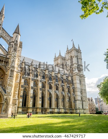 LONDON - MAY 24: Westminster Abbey, one of the most notable religious building in UK, under cloudy blue sky in London, England, was taken on May 24, 2016.