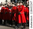 LONDON - NOV 11 : Members of Chelsea Pensioners on Remembrance Day, 11th every Nov, to remember armed forces who have died since First World War, Parade on Nov 11, 2012, London, UK. - stock photo