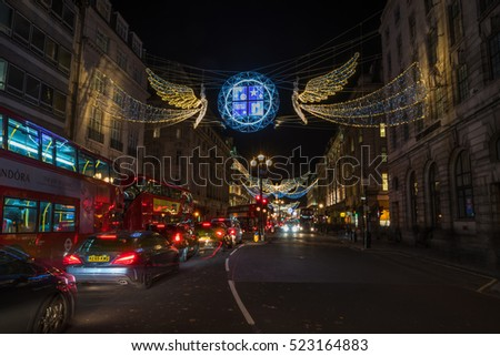 LONDON - NOVEMBER 25, 2016: Christmas lights on Regent Street, London, UK. The Christmas lights attract thousands of shoppers during the festive season and are a major tourist attraction in London