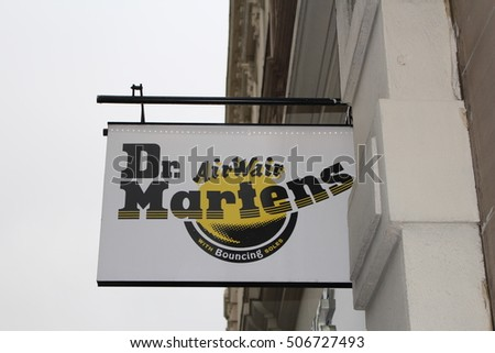 London, October 2016 - the Doc Martens logo is displayed outside a footwear retailer in London's West End