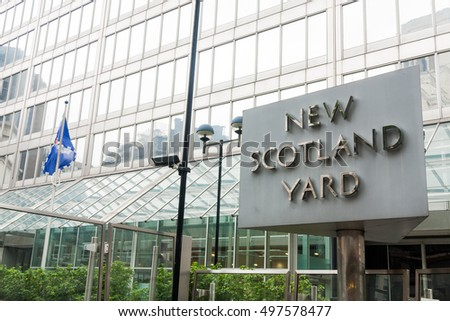 LONDON â???? SEPTEMBER 9, 2011: Sign outside the New Scotland Yard building. Scotland Yard is the headquarters of the Metropolitan Police Service.