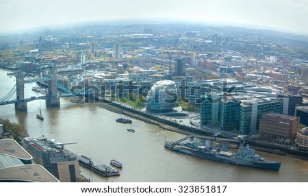 LONDON, UK - APRIL 22, 2015: City of London aerial view, river Thames and Tower bridge. London panorama form 32 floor of Walkie-Talkie building