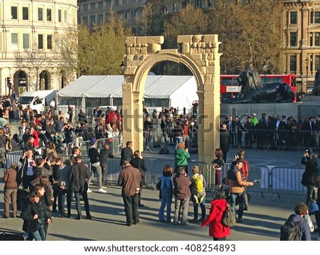 LONDON, UK - APRIL 19, 2016:  Crowds in London's Trafalgar Square surrounding a recreation of the Arch of Triumph from the Syrian city of Palmyra.  The ruin has been recreated using 3D printed marble.