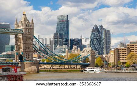 LONDON, UK - APRIL 30, 2015: Tower bridge and City of London financial aria on the background. View includes Gherkin and other buildings