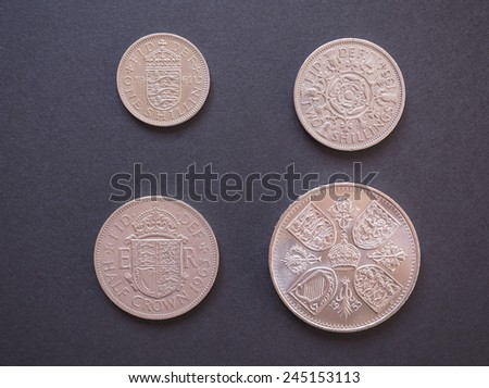 LONDON, UK - CIRCA DECEMBER 2014: one shilling, two shillings, half-crown, crown Predecimal British Pound coins, withdrawn on Decimal Day, i.e. 15 February 1971