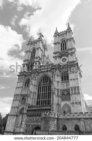 LONDON, UK / CIRCA JULY 2014 - Wide view of the famous Westminster Abbey in Central London on a summer day with dramatic clouds in the background