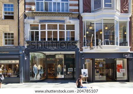 LONDON, UK - JULY 03, 2014: Bond street boutiques, street of famous small fashion businesses