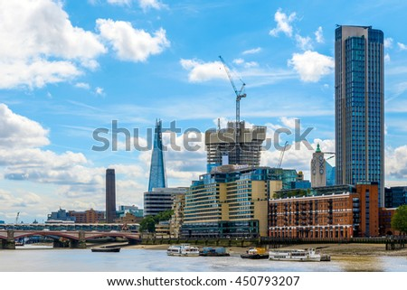 London, UK - July 5, 2016 - London cityscape including Blackfriars Railway Bridge, Tate Modern, The Shard, Sea Container House, OXO Tower and South Bank Tower