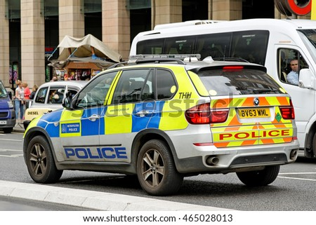 LONDON, UK - JULY 8, 2016: London Metropolitan Police vehicle in the City of London. The Met was formed in 1829 and as of 2011 employed 48,661 staff making it one of biggest employers in London.