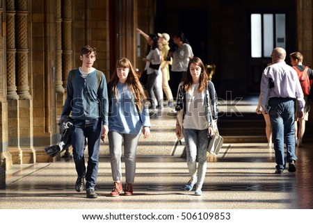 London, UK - June 16, 2015: People walk along a corridor in the Natural History Museum. Established in 1881 the museum houses 80 million items from around the world.