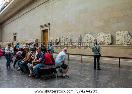 LONDON, UK - JUNE 4, 2015: Unidentified visitirs in the hall with Marble from Acropolis Greece or Elgin marble in British museum