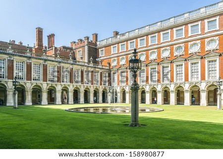 LONDON, UK - JUNE 4, 2013: View of Fountain Court in Hampton Court Palace in London. Hampton Court was originally built for Cardinal Thomas Wolsey, a favorite of King Henry VIII, circa 1514.