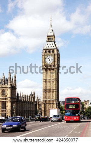 London, UK - May 21, 2011: Traffic on Westminster Bridge passing Big Ben and the Houses of Parliament