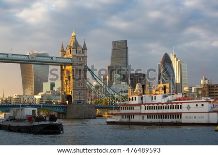 LONDON, UK - SEPTEMBER 19, 2015: Tower bridge and city of London modern buildings . View from the embankment at sunset