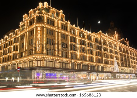 LONDON, UNITED KINGDOM - CIRCA NOVEMBER 2013:Harrods department store. Facade illuminated at night.