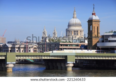 London, United Kingdom - cityscape with famous St. Paul's Cathedral and Cannon Street railway bridge.