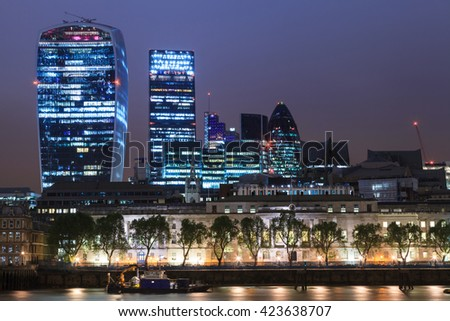LONDON, UNITED KINGDOM - 19 MAY 2016: London city skyscrapers view over Thames River During Night Time