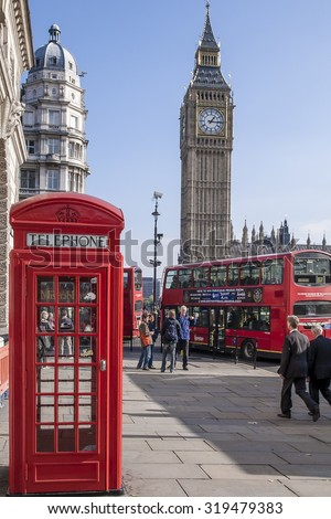 LONDON, UNITED KINGDOM - OCTOBER 23, 2007:  View of people waking by the red telephone box and Big Ben in London.