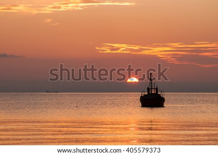 Lonely fisher's boat in the beautiful sunset