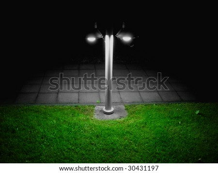 Lonely lamppost in darkness