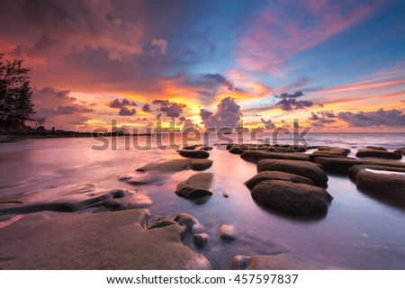 Long Exposure  Of Colorful Sunset And Unique Formation Of Green Moss Covered Rocky Beach. Tindakon Dazang Beach, Sabah, Malaysia. Image contain soft focus and blur.