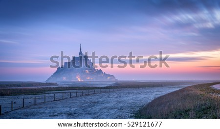 long exposure of sunrise at mont saint michel