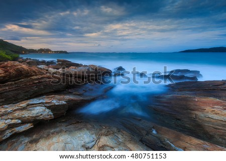 Long Exposure of Sunset at the sea with rocks in foreground, Khao Laem Ya Mu Ko Samet National Park Rayong,Thailand