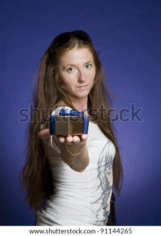 long hair smiling woman with box gift in a hand