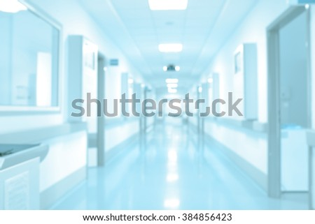 Long hospital hallway, background unfocused.