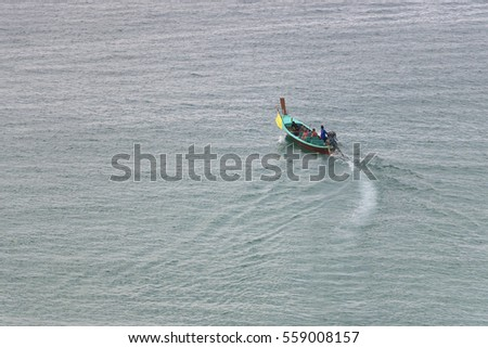 Long tail boat on the sea.