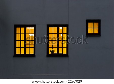 Look through a windows from outside to inside. Two large and one half size windows
