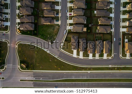 Looking Straight down Over Suburb Community homes near Austin Texas modern neighborhood layout new development