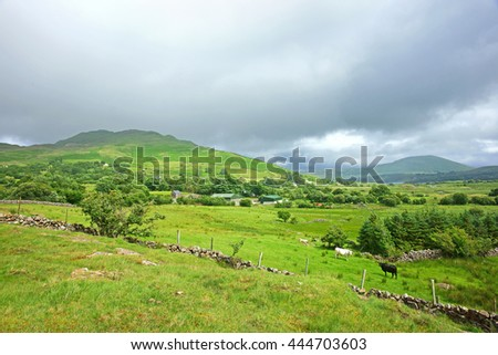 Looking towards across open countryside from Joyce's Country towards Lough Mask in Summer time, County Mayo, Ireland