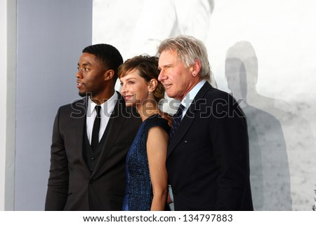 "LOS ANGELES - APR 9:  Chadwick Boseman, Calista Flockhart, Harrison Ford arrives at the ""42"" Premiere at the Chinese Theater on April 9, 2013 in Los Angeles, CA"