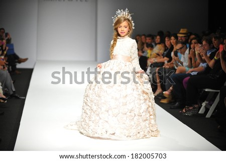 LOS ANGELES, CA - MARCH 10: A child model walks runway at Nancy Vuu Children fashion show during Style Fashion Week Fall 2014 on March 10, 2014 in Los Angeles.