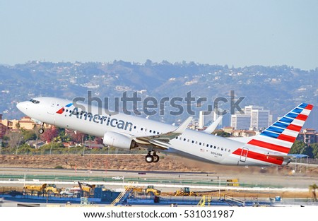 LOS ANGELES/CALIFORNIA - DEC. 3, 2016: American Airlines Boeing 737-823 aircraft is airborne as it departs Los Angeles International Airport, Los Angeles, California USA
