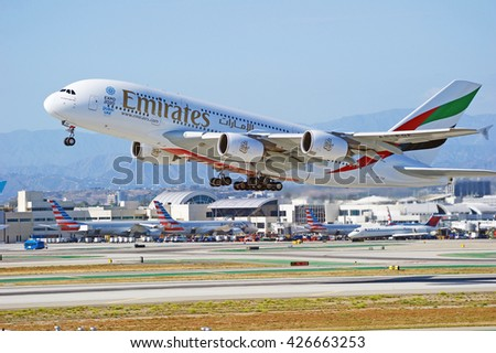 LOS ANGELES/CALIFORNIA - MAY 22, 2016: Emirates Airlines Airbus A380 is airborne as it departs Los Angeles International Airport in Los Angeles, California, USA