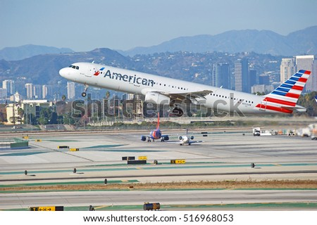 LOS ANGELES/CALIFORNIA - NOV. 13, 2016: American Airlines Airbus A321 aircraft is airborne as it departs Los Angeles International Airport, Los Angeles, California USA