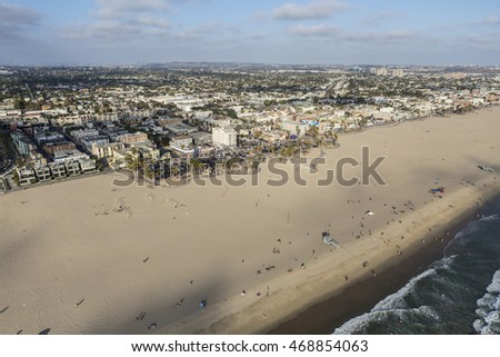 Los Angeles, California, USA - August 6, 2016:  Summer afternoon aerial view of broad sandy Venice Beach in Southern California.