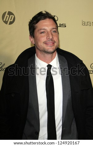 LOS ANGELES - JAN 13:  Simon Rex arrives at the 2013 Weinstein Post Golden Globe Party at Beverly Hilton Hotel on January 13, 2013 in Beverly Hills, CA..