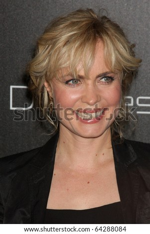 LOS ANGELES - NOV 2:  Radha Mitchell arrives at the Decades Denim Fashion Show at Private Home on November 2, 2010 in Beverly HIlls, CA