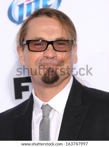 "LOS ANGELES - SEP 07:  Kurt Sutter arrives to ""Sons of Anarchy"" Season 6 Premiere  on September 07, 2013 in Hollywood, CA"